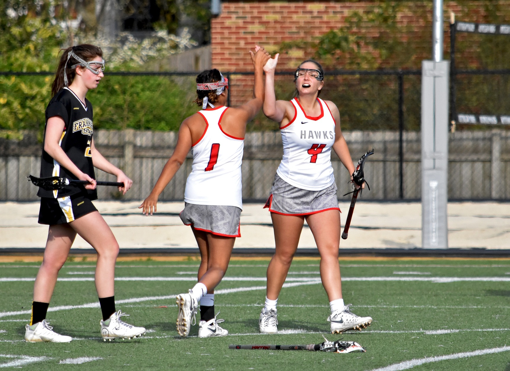 Huntingdon's Jade Paul (#1) is congratulated by Carolyn Smith (#4) after Paul's second goal in Thursday's loss to Framingham State. (Photo by Wesley Lyle)