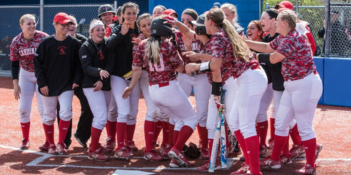 Jenna Lowney is met by teammates after her solo home run in the 3rd inning (Photo courtesy of Keepers by Kelly)