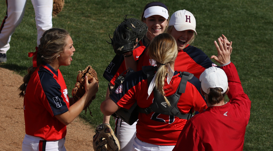 Blue Dragon players and head coach Jaime Rose congratulate rightfielder Brynne Stockman after robbing a home run in the seventh inning of a 4-3 Dragon victory in Game 1 over No. 9 Highland on Thursday at Fun Valley. (Joel Powers/Blue Dragon Sports Information)