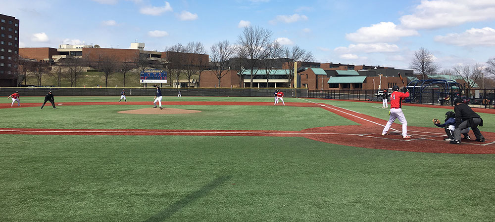 Gallaudet pitcher Dylan Hayes throws a pitch at Hoy Field on a sunny and clear day.