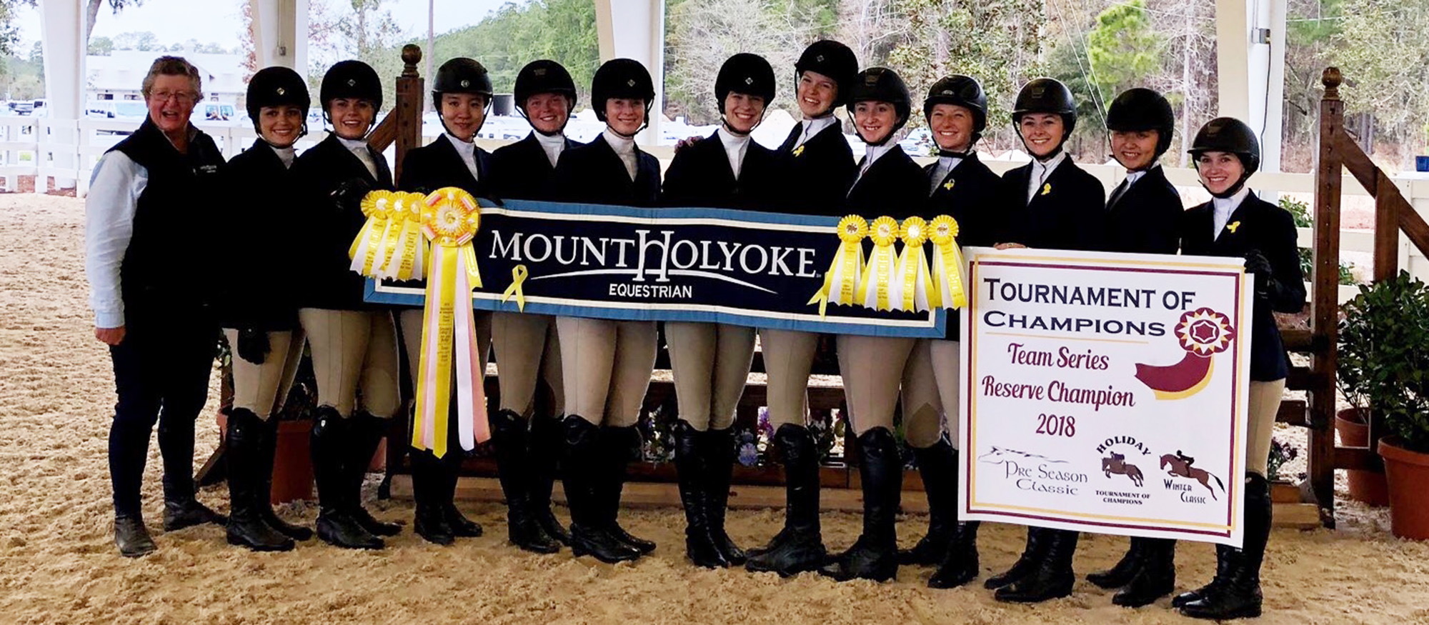 Photo of the Lyons riding team members posing after finishing third at the Winter II Tournament of Champions. MHC was the Tournament of Champions Reserve Champions for 2017-18.