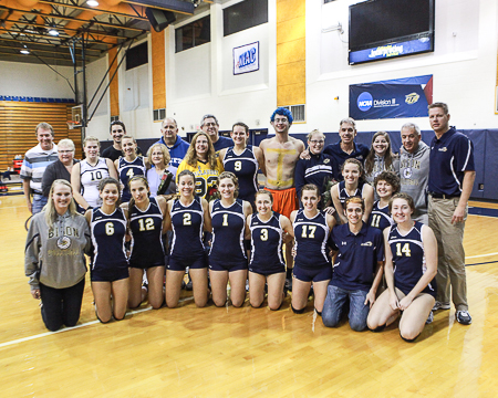 Gallaudet's women's volleyball team with the family members of the three Bison seniors.