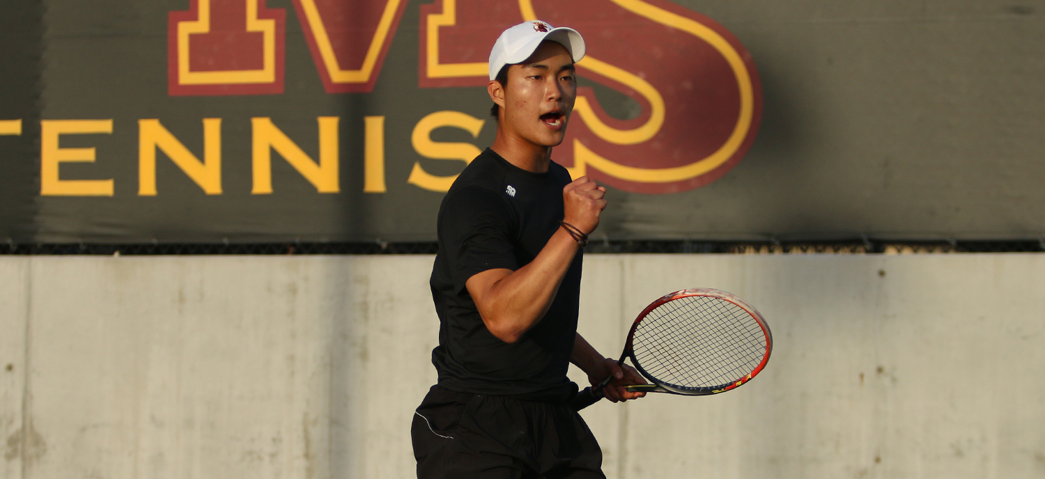 Robert Liu celebrates after his doubles victory in the #3 match.