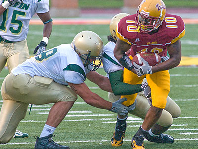 Sophomore tailback David Freeman plunges ahead for yardage against Tiffin (Photo by Ed Hyde, FSU Photographic Services)