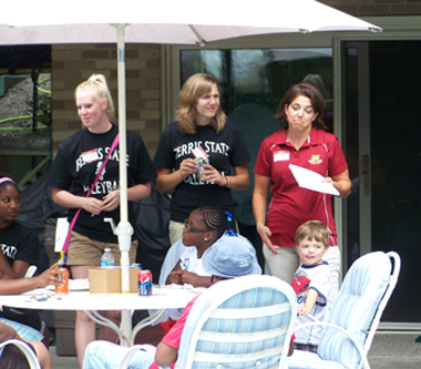 Head coach Tia Brandel-Wilhelm gives volleyball bingo game instructions.  (Photo by Joe Gorby)