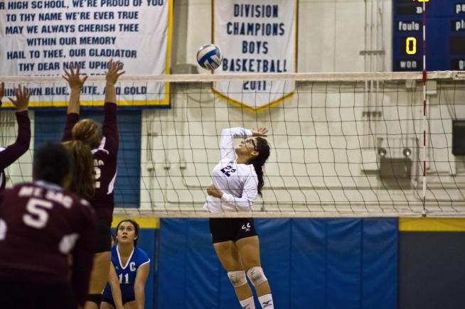 File Photo: Stephanie Ortiz (22) posted six kills and 10 digs in the Falcons four-set loss to Long Beach City.