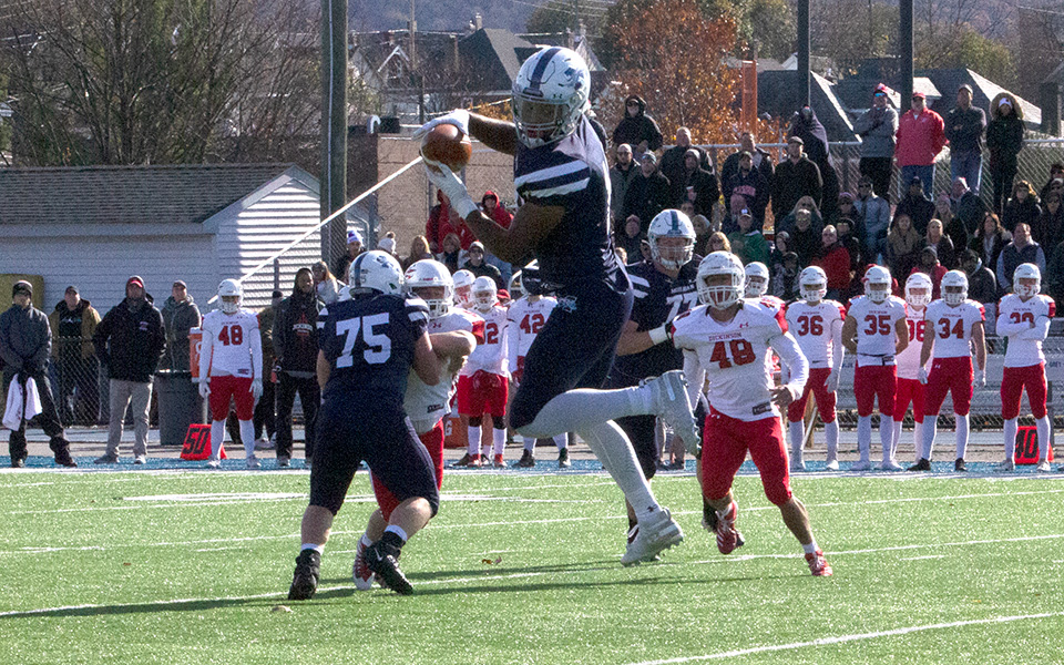 Senior Alex Pierce pulls in one of his career-high 12 receptions versus Dickinson College at Rocco Calvo Field.