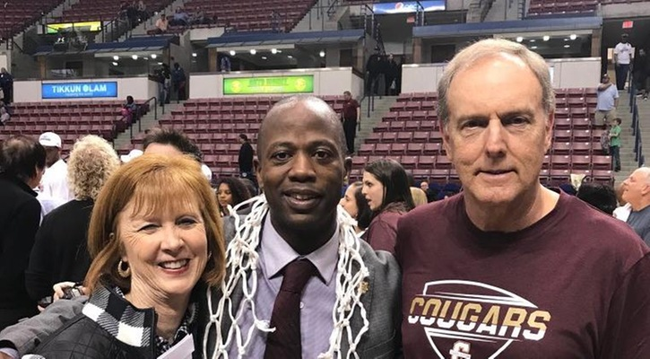Coach Earl Grant with Coach Terry Sellers and Cathy Sellers