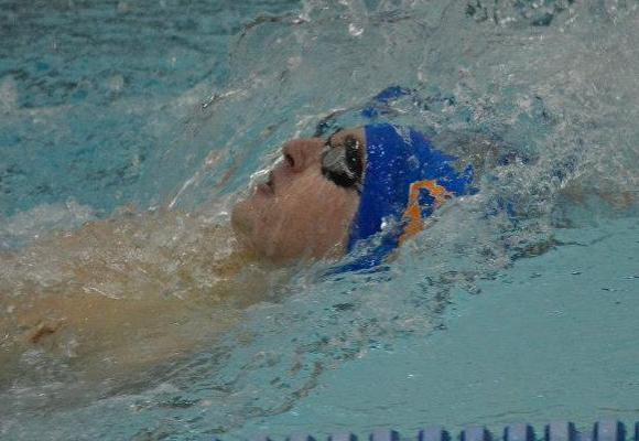 Brindamour Competes in 100 Backstroke