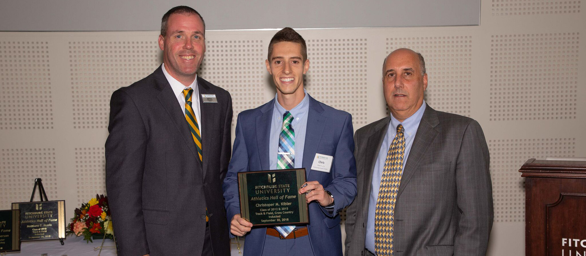 MHC head cross country and track & field coach, Chris Kibler is pictured with representatives from Fitchburg State during his induction into the Fitchburg State Athletics Hall of Fame.