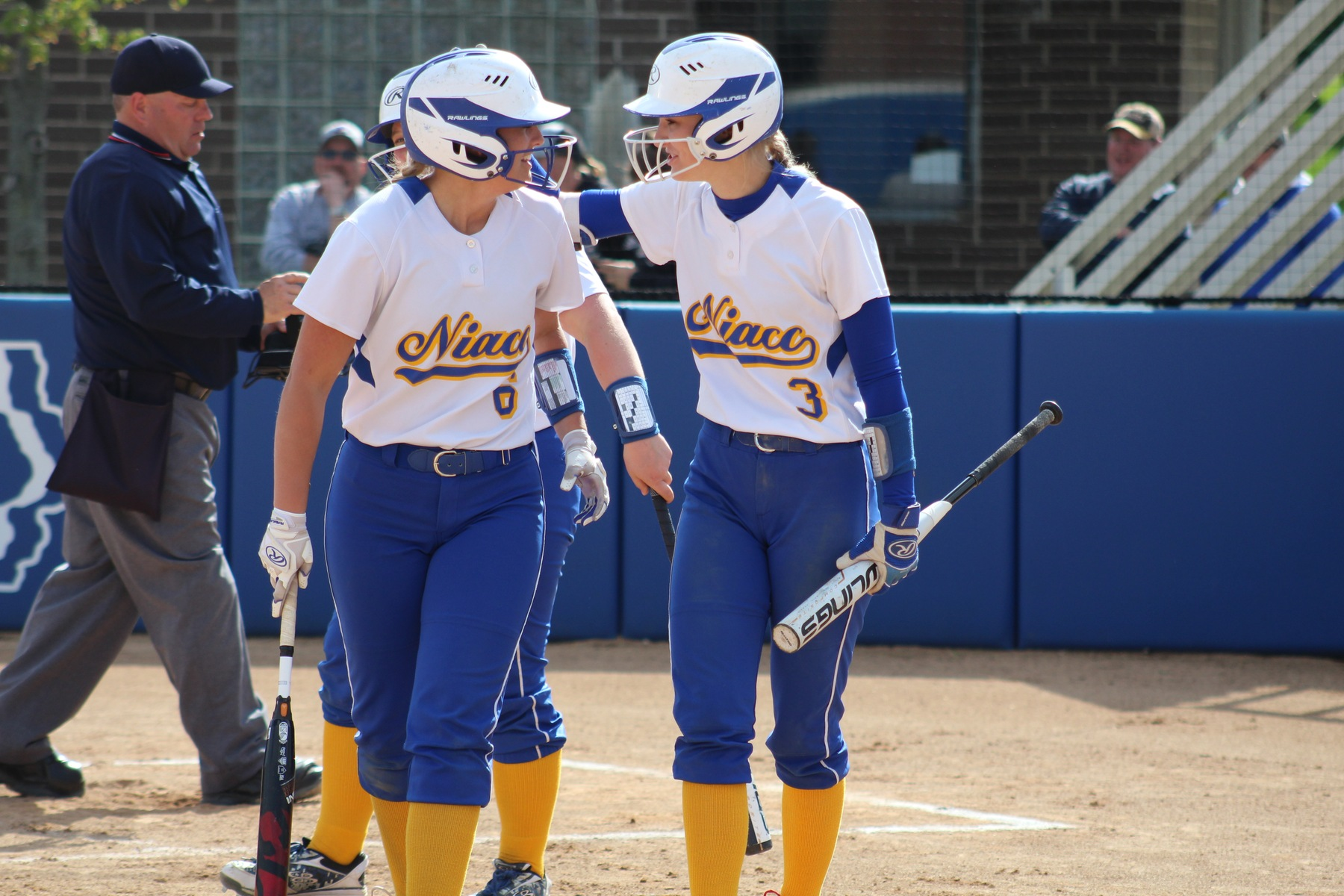 Morgan Kelley (left) gets congratulated by Hannah Faktor after hitting a solo home run in the fourth inning.