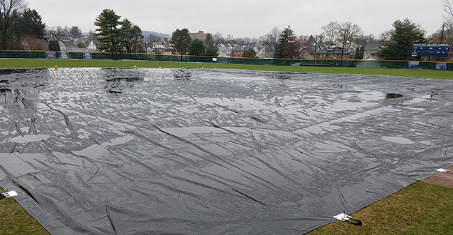 Gillespie Field cover by a new full infield tarp.