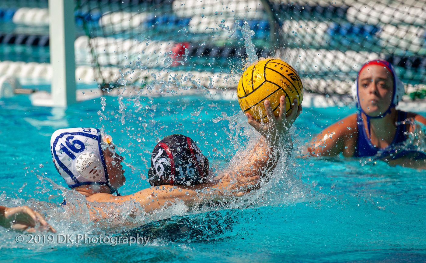 Jade Grey-Aleman (#16), City College freshman is smothered as she attempts a goal shot in the match against Citrus College at ARC Pool on Sept. 13th.