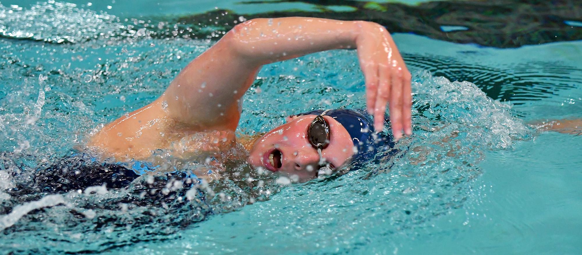 Action photo of Lyons swimmer, Natalie Burkett