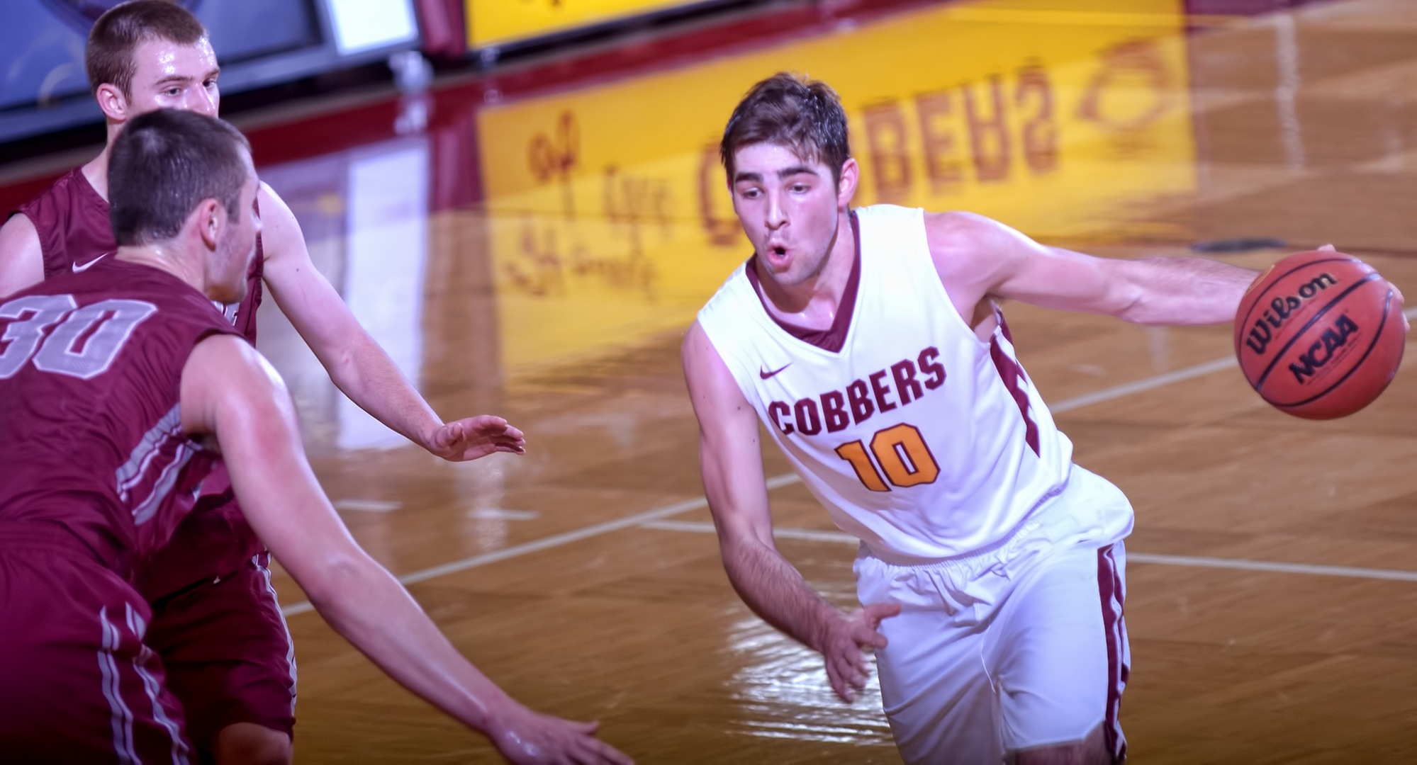 Sophomore Tommy Schyma dribbles to the basket for two of his team-high 16 points against Hamline. Schyma also had 11 rebounds and six assists.
