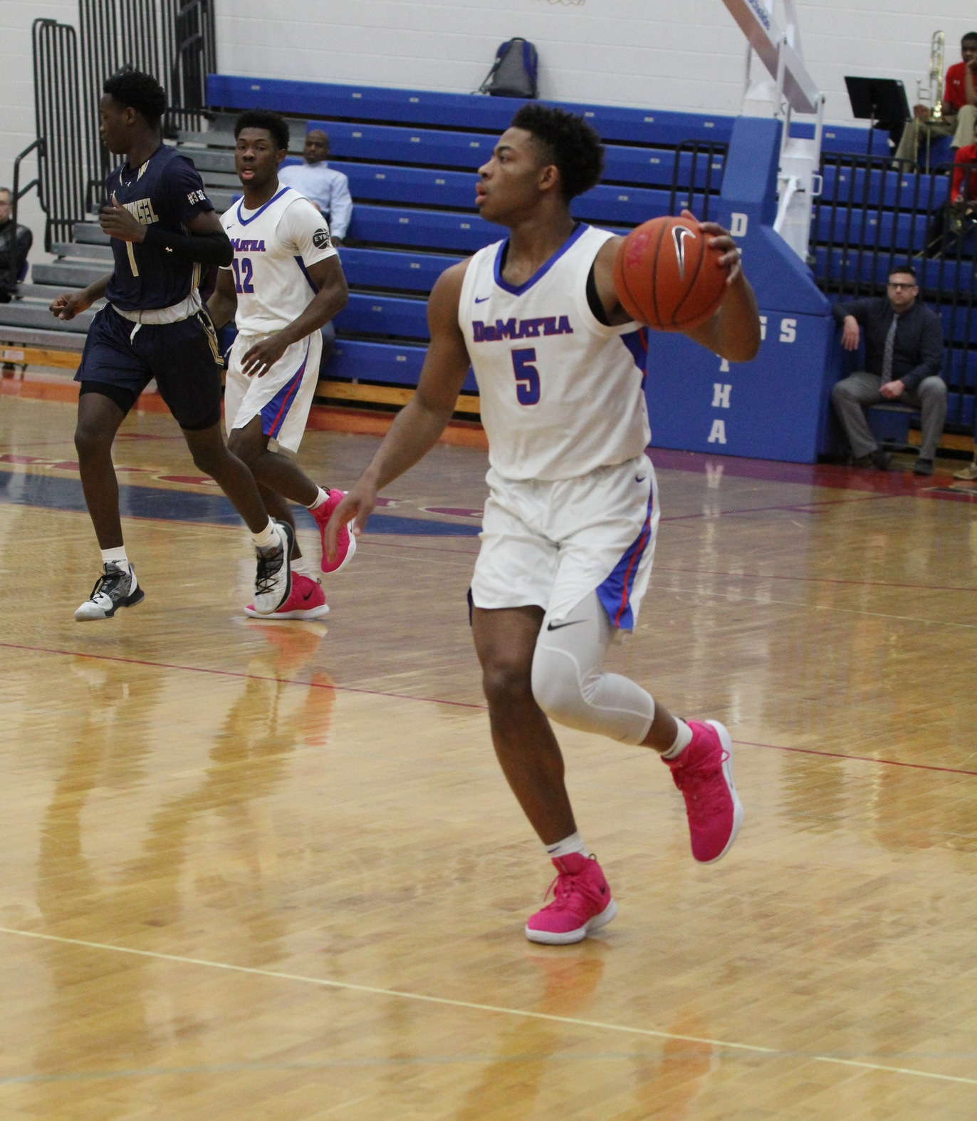 With the win in the Alhambra Championship game, DeMatha Senior Justin Moore (#5) set the program's record for varsity wins with 123.