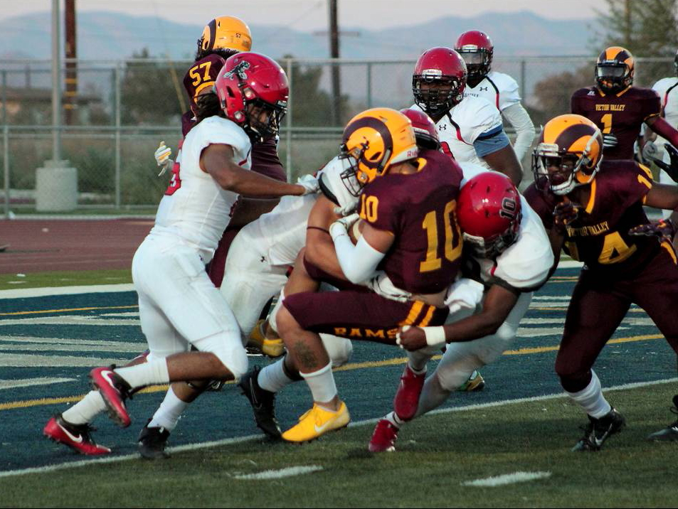 Chaffey defensive football players tackle Victor Valley offense