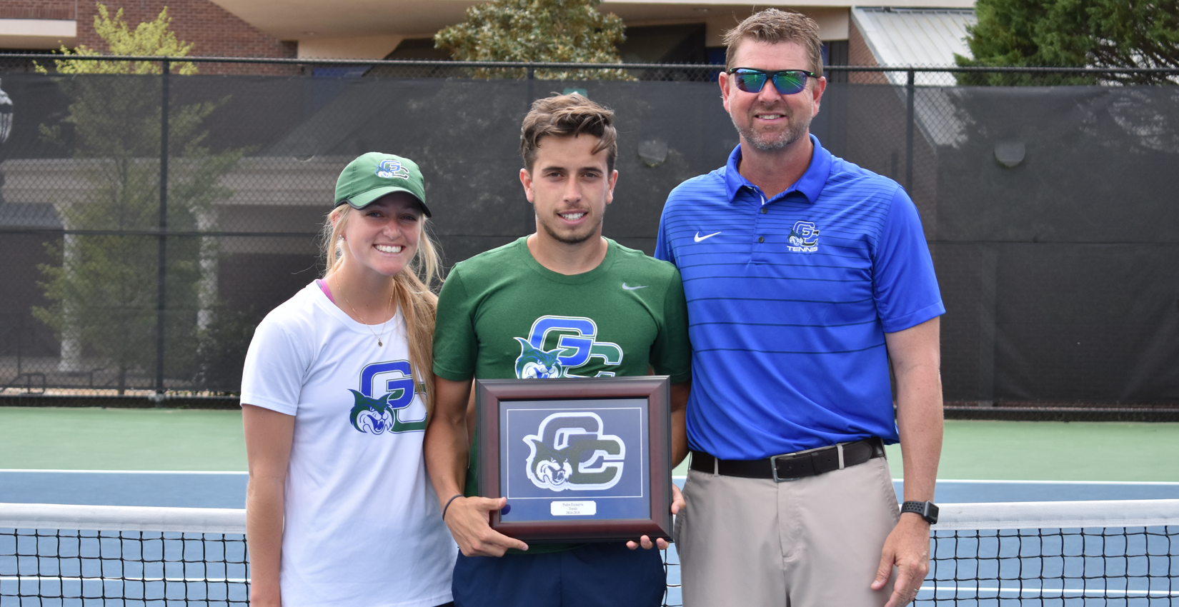 Assistant coach Katie Krupp, senior Pedro Ecenarro and head coach Steve Barsby