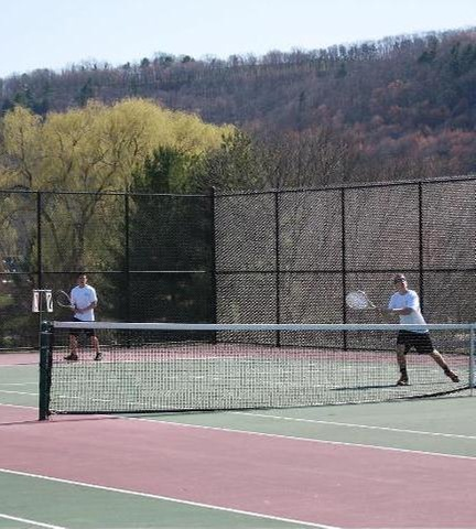 Broome players in doubles match