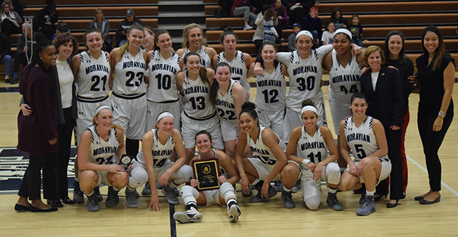 The Greyhounds with the championship plaque at the 15th Roosevelt's Greyhound Classic with a win over William Paterson.