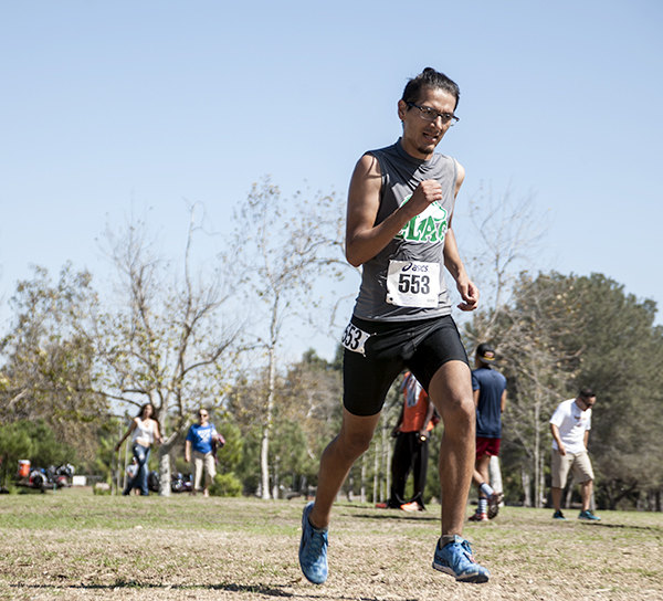 FROZEN IN TIME—Sophomore Andrew Perez, the East Los Angeles College No. 2 men's team runner, pushes forward sprinting at the finish line in the 2015 Golden West Classic, Friday Sept. 25, 2015 in Huntington Beach. Photo by Tadzio Garcia