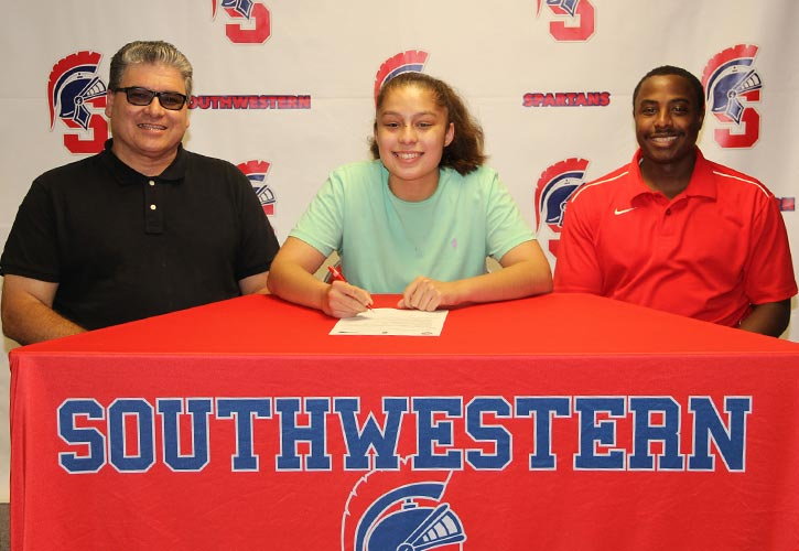 Pictured:  Rafael Aviles, Jasmine?s father; Jasmine Aviles; and Southwestern Head Women?s Basketball Coach Addae Houston
