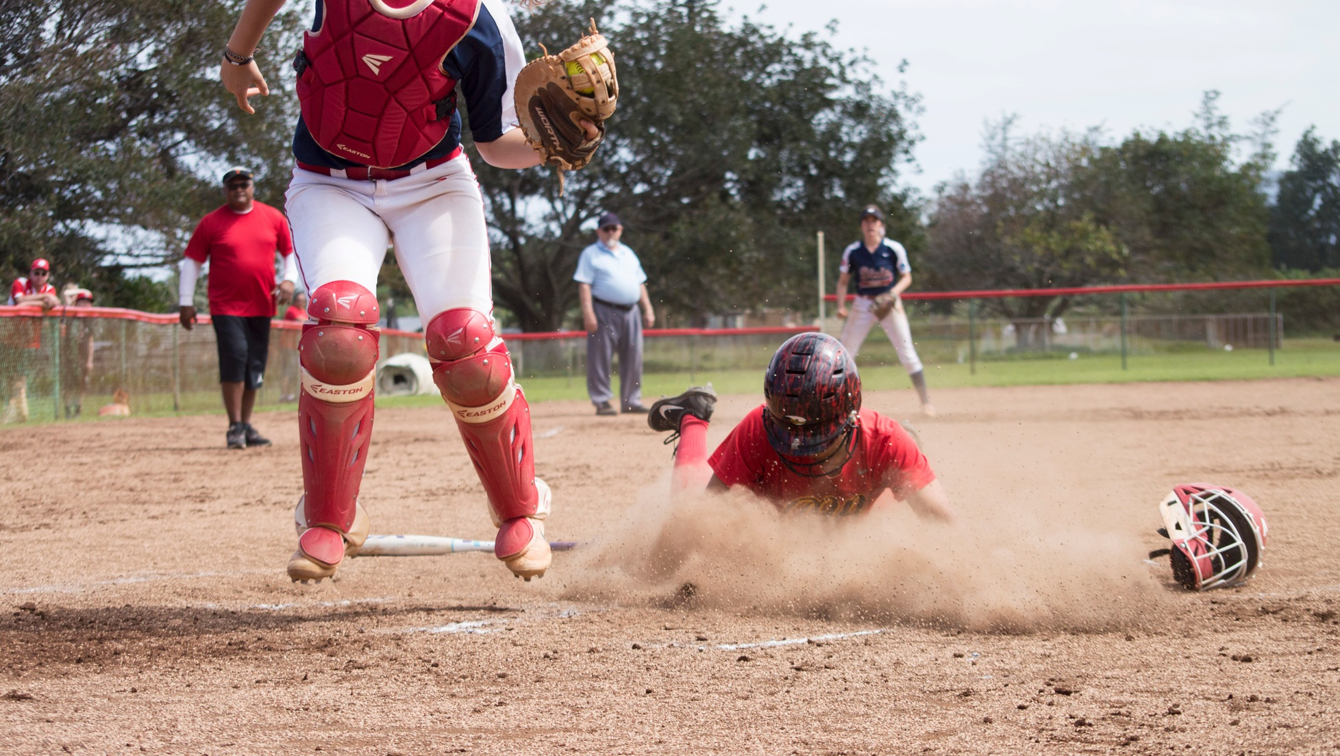Lizabelle Talataina slides into home for the walk-off run in the first game against No. 13 Dixie State.