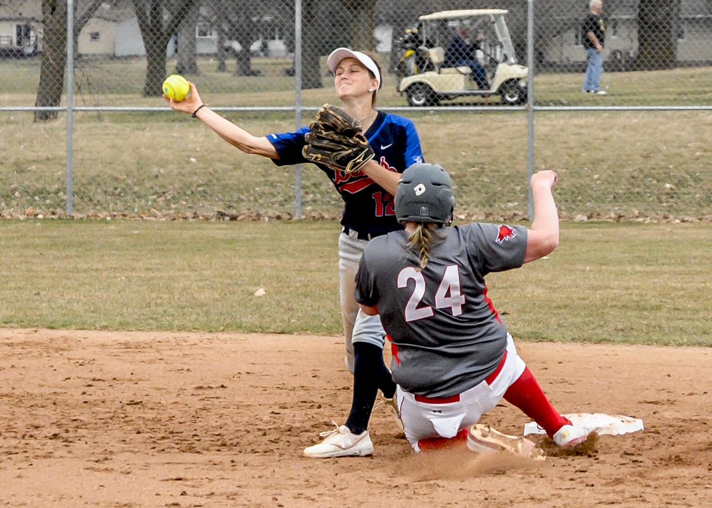 Mia Ruther turning a double play