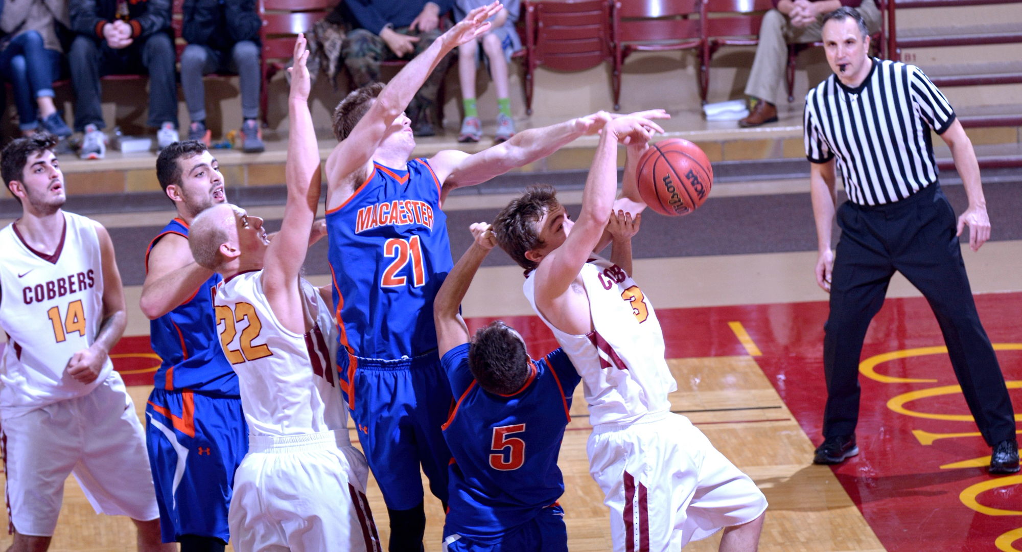 Senior Zach Kinny drives the lane during the Cobbers' game on Monday with Macalester. Kinny went 5-for-10 from the floor and finished with 16 points.
