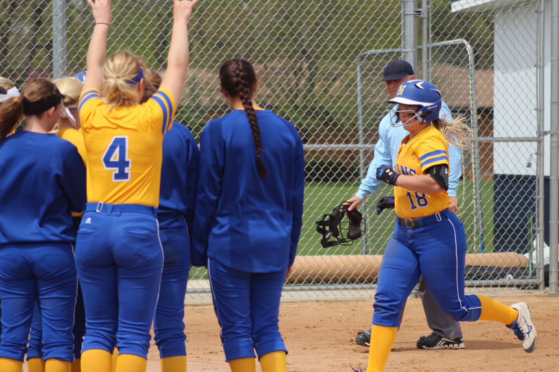 NIACC players celebrate as Shelby Low approaches home plate after hitting a solo home run in the third inning.