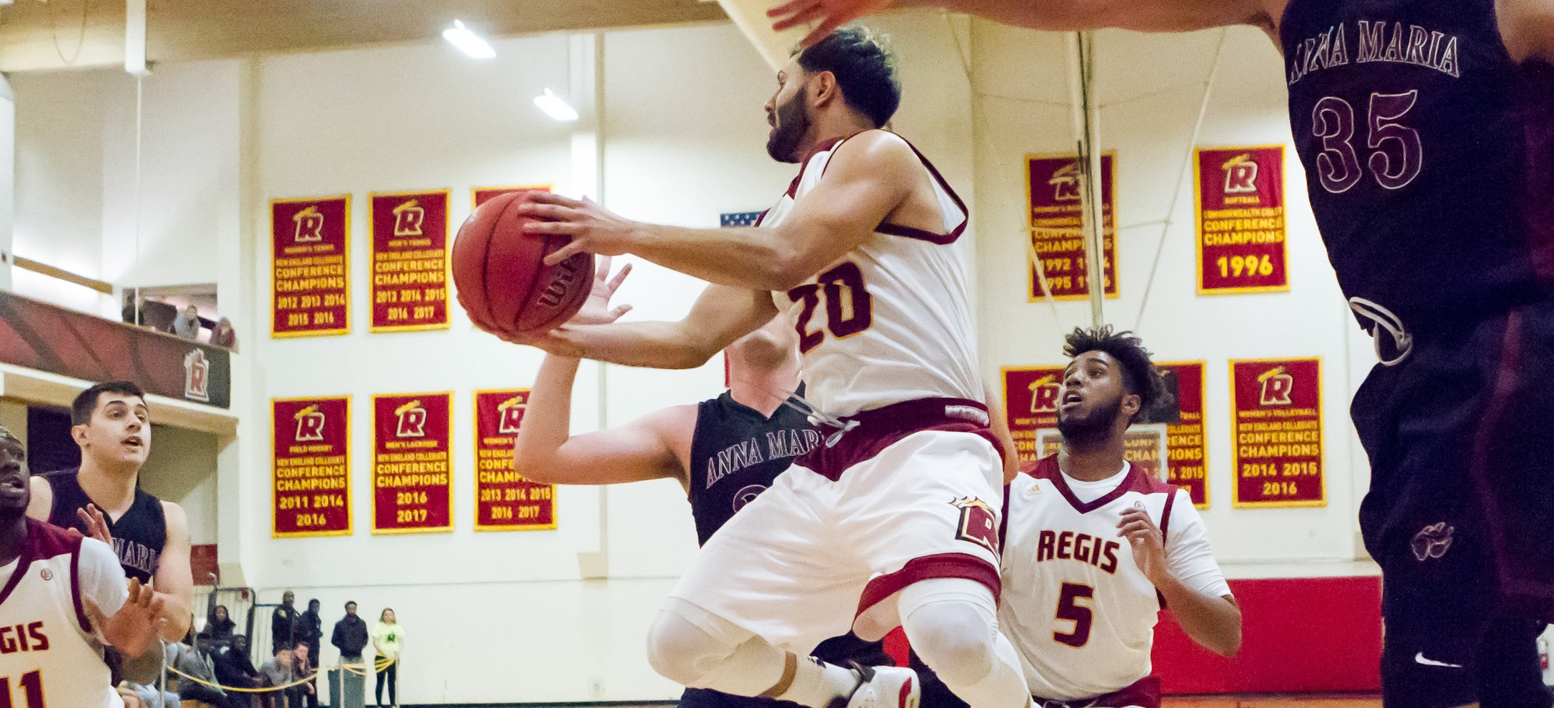 Men's Basketball Holds On For Road Win At Rivier