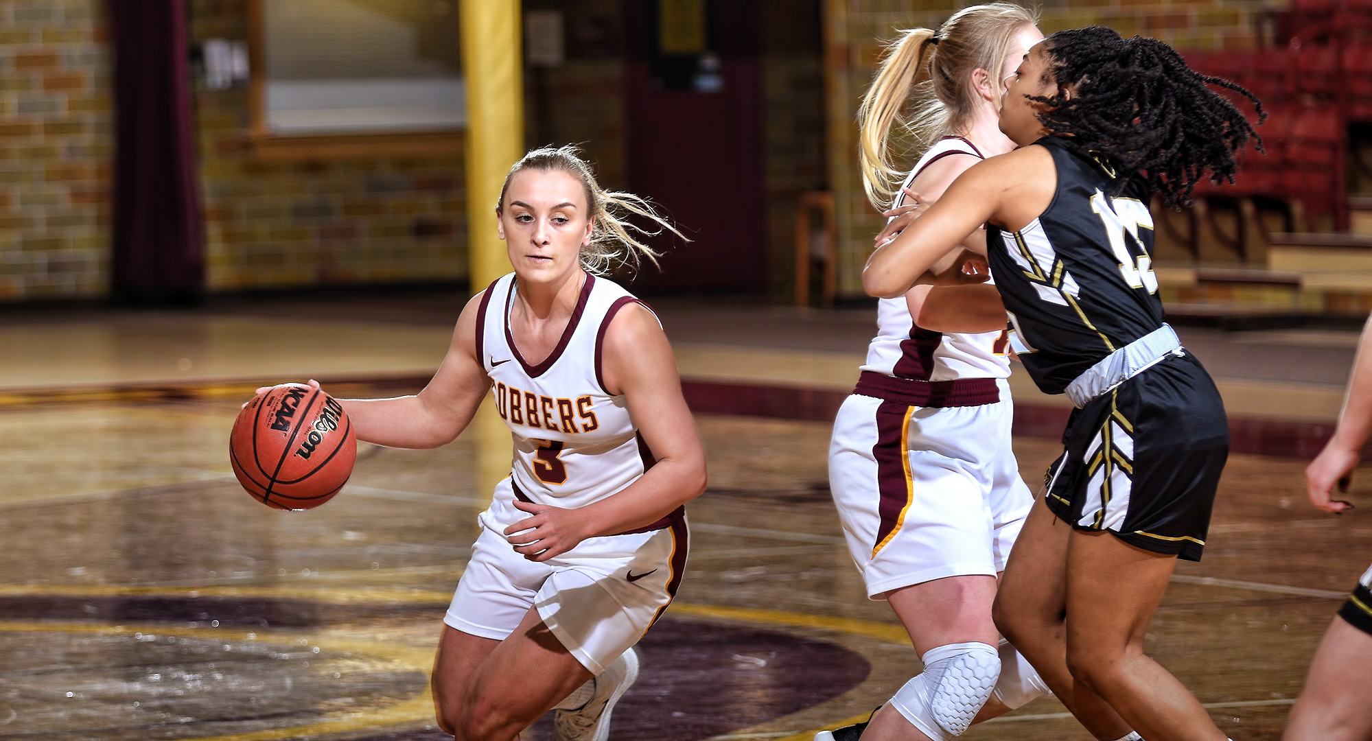 Sophomore Autumn Thompson cuts around a ball screen on the way to the basket in the first half of the Cobbers' OT win over St. Olaf. Thompson finished with a team-high 20 points.