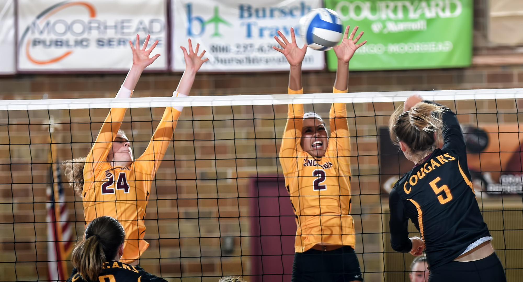 Anna Brakke (right) and Kendra Wiggs led the Cobbers in kills at the 3-match Northwestern Invite.