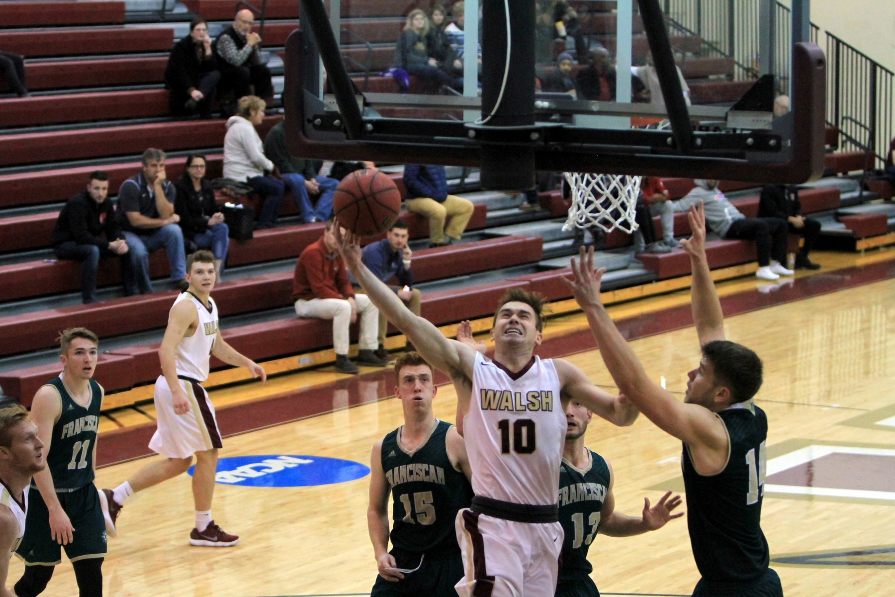 Six Scorers in Double Figures Lead Walsh, 99-65