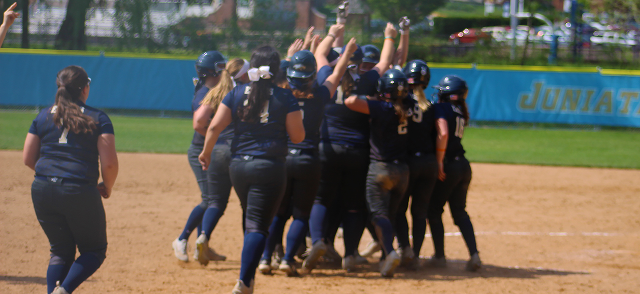The Eagles celebrate after Allie Baney's walk off RBI single in Game 1 against Elizabethtown.