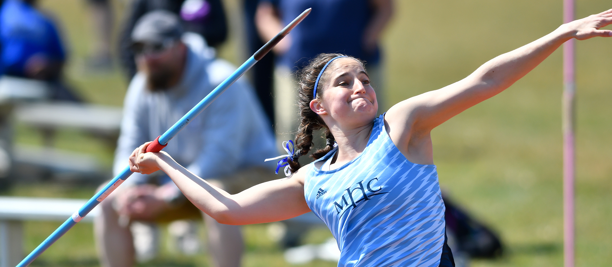 Action photo of Lyons track & field athlete, Ireland Clare Kennedy competing in the javelin.