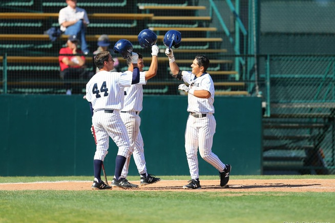 Ramon Bramasco (right) is greeted by teammates after his two-run home run