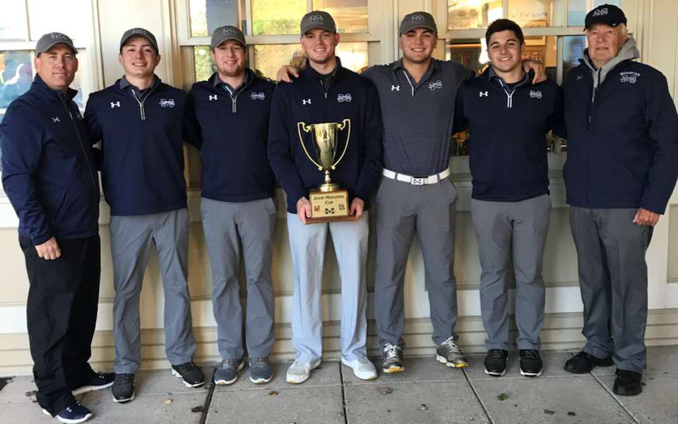 Head Coach Kevin Edwards, Kody Kolnik, Nick Kuhn, Joe Rochelle, Thomas Lakata, Victor Tavares and Head Coach Emeritus John Makuvek pose at Brookside Country Club after winning the John Makuvek Cup for the fourth straight year.