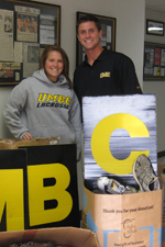 SAAC President Natalie Rau and Secretary Curtis Schickner with the donated shoes.