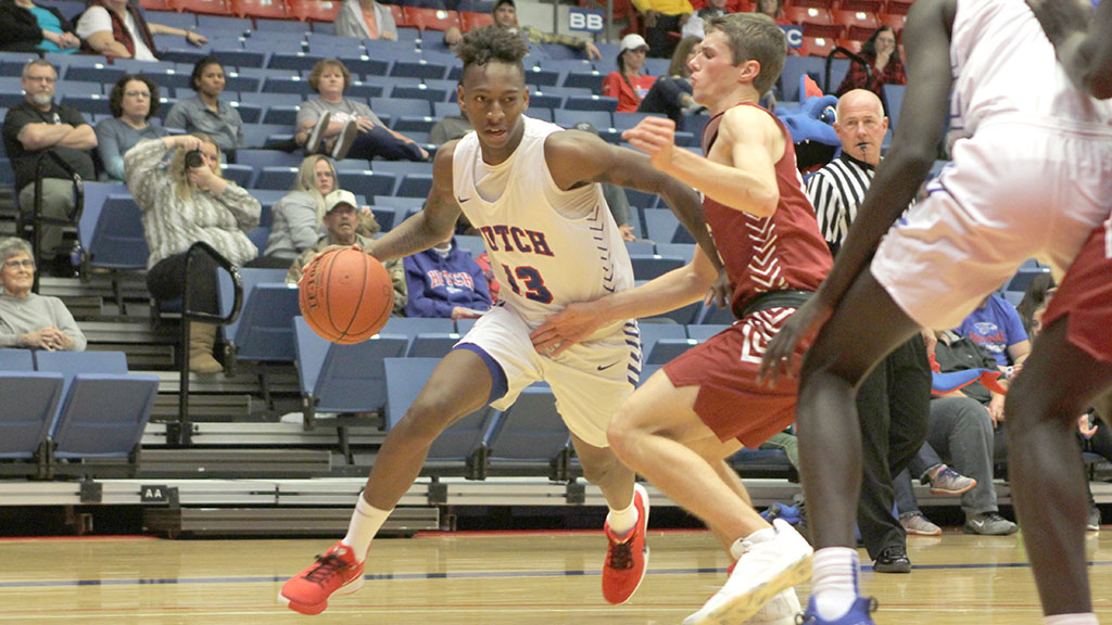 Josh Baker scores a team-high 21 points to lead the No. 4-ranked Blue Dragons to an 87-53 victory over Hesston College on Tuesday at the Sports Arena. (Bre Rogers/Blue Dragon Sports Information)