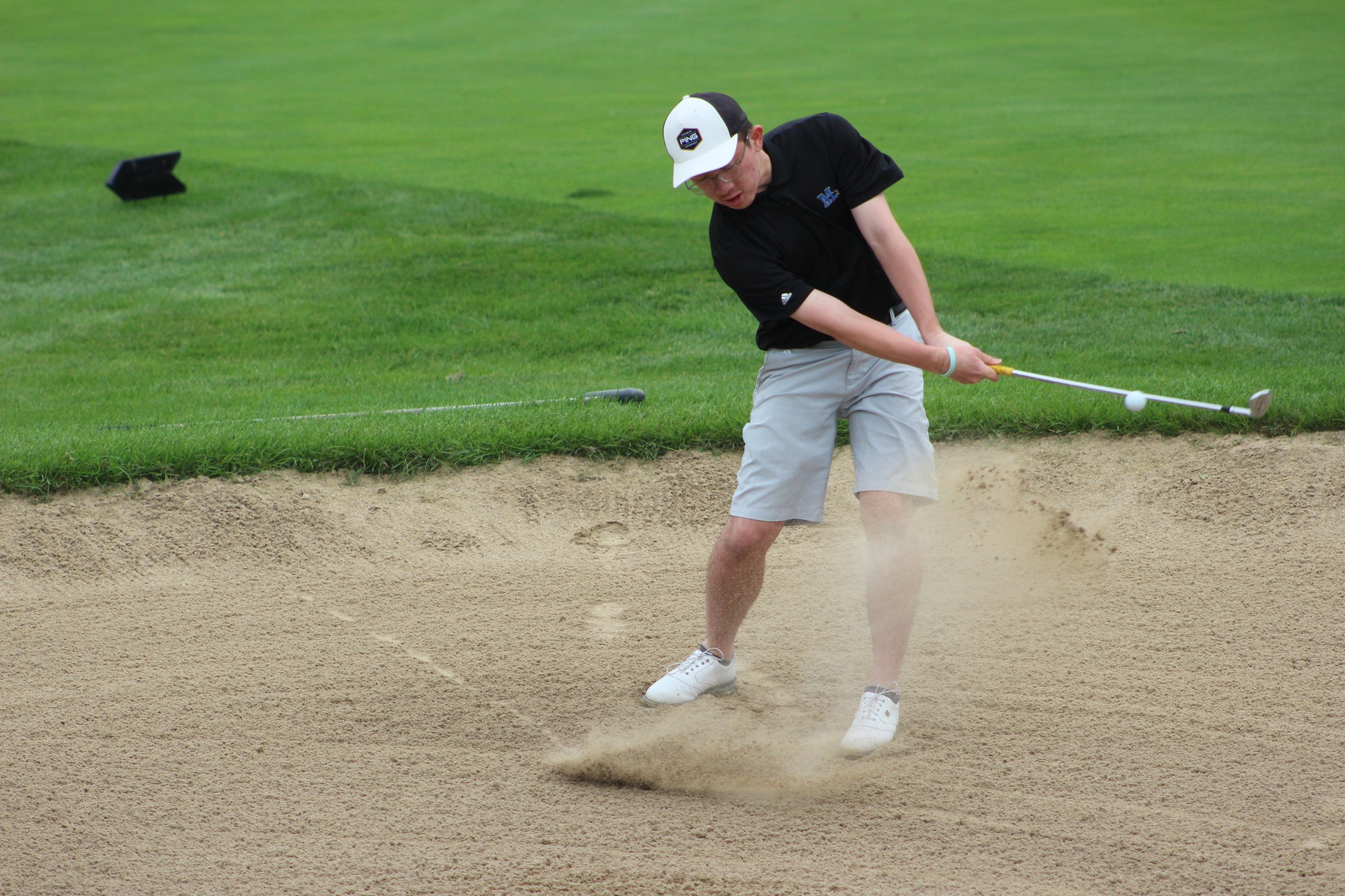 Jarryd Gano chips out of a sand trap.