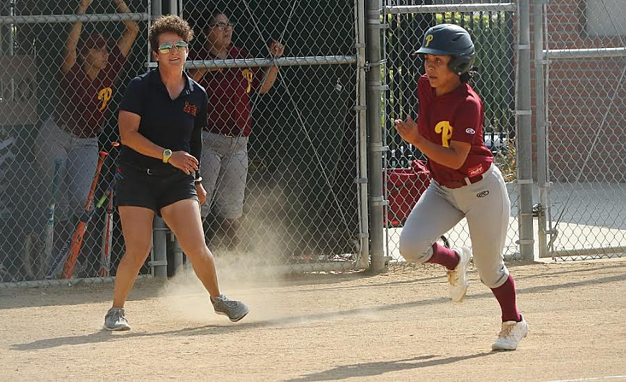 PCC softball coach Monica Tantlinger coaching third with Jeneve Medrano on her way home during the team's win over Orange Coast on Monday, photo by Richard Quinton.
