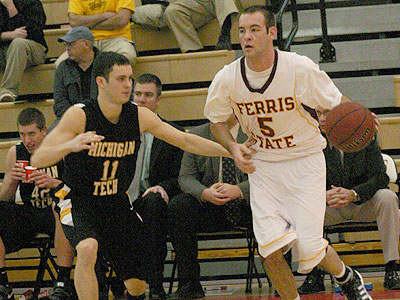 FSU's Matt DeHart works against MTU's Erik Stephens (Photo by Sandy Gholston)