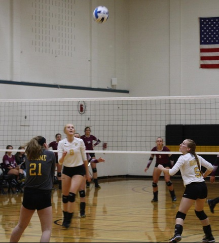 SUNY Broome volleyball player digs ball