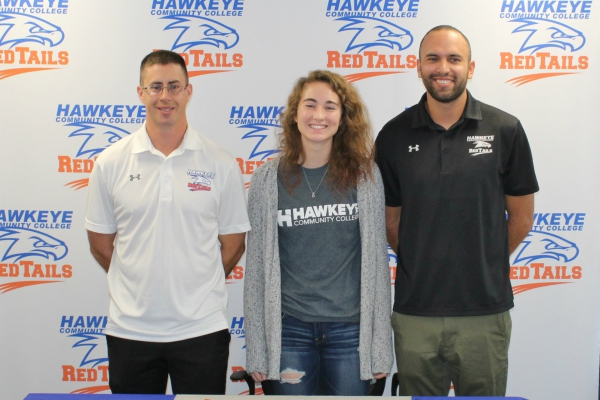 Madison Larsen (middle) with head coach Micah Ruroden (left) and assistant coach Tyler Mulder (right).