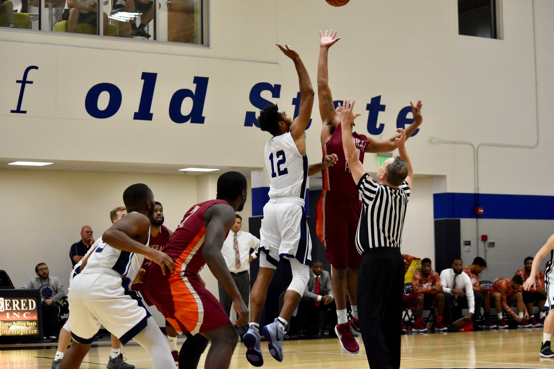 Junior Justin Luton (#12) jumps for Penn State York at tip-off.