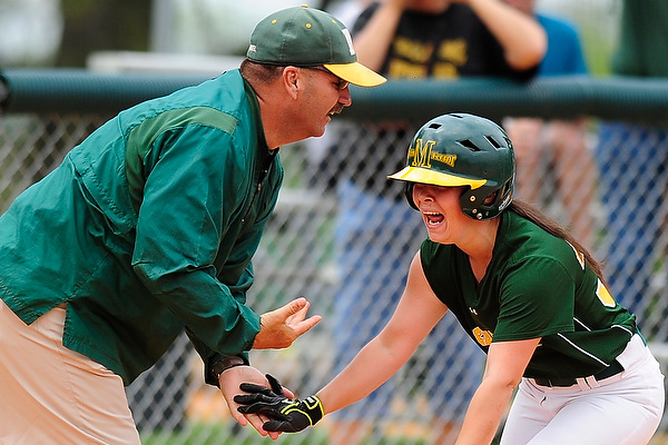 Amy Baumgardner celebrates with Coach Smith rounding third on her first career home run. � 2012 David Sinclair/McDaniel College
