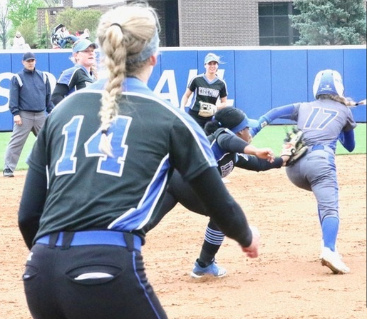 Kaitlyn Carlson of NIACC is tagged by Kirkwood third baseman London  Jackson after Carlson got caught in a rundown during Saturday's regional softball game at Kirkwood. Number 14 for Kirkwood is Lauren  Kuch. (MSR photo by Margaret O'Banion)