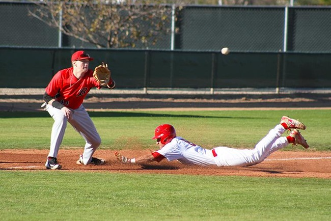 Esteban Martinez slides safely into third after roping a line drive down the right field line that scored Mesa's first run of the season. (photo by Aaron Webster)