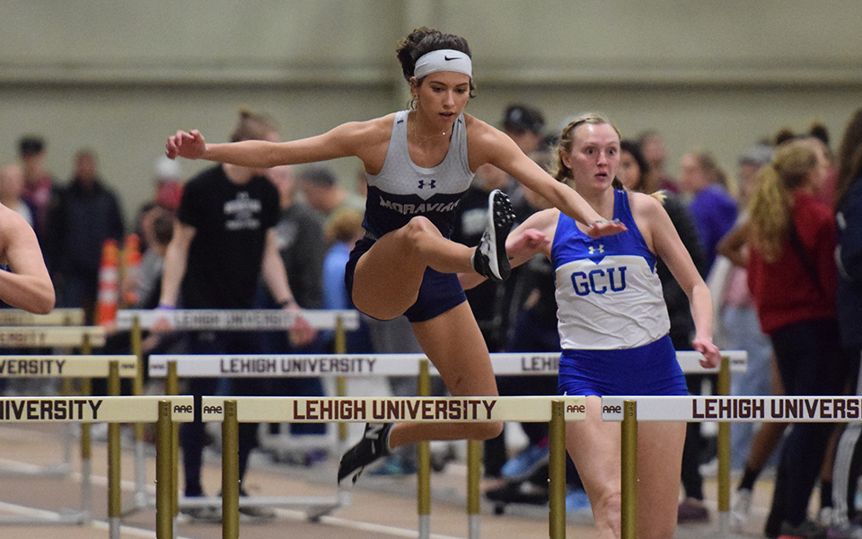 Ally Lambert clears a hurdle during the Moravian Indoor Meet at Rauch Fieldhouse in January 2019.